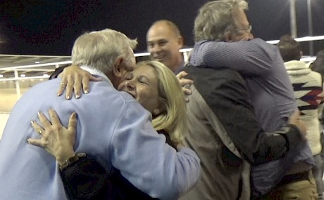 Sharing the joy … hugs all round with a big team of ecstatic owners after Northview Hustler's Spring Cup win