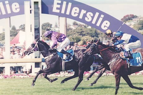 Jockey Bruce Herd pumps his fist as Mikki Street downs the favourite Sharvasti (Noel Harris ) to win the 2006 Zabeel Clasic at Ellerslie.