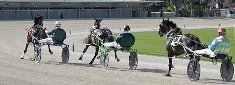 Man Of Action is green, running wide when leading on the bend out of the home straight.