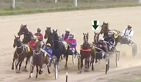 Barkley and Chris McDowell, arrowed, are badly held up by the tiring trailer Out Of The Shadows turning for home at Oamaru on Saturday.