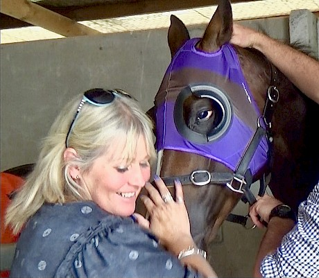 Lincoln Falls with trainer Lisa Latta on Saturday, nails and hood in matching stable purple.