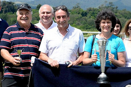 Steve Hollander, left, and wife Karen enjoying the spoils of Wellington Cup and Otaki Cup winner Jet Black Shadow with the writer. PHOTO: Royden Williams.