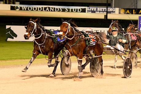 Driver Andre Poutama gets the best out of Tommy Lincoln, outer, as he staves off The Empress. PHOTO: Peter Rubery/Race Images.