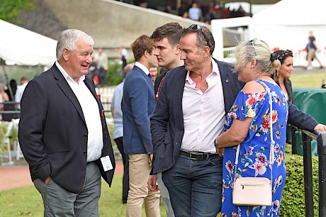 Neville McAlister, centre, enjoys the moment with trainer Lisa Latta and Lincoln Farms' business manager Ian Middleton.