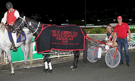 Northview Hustler, with trainer Al Barnes and his son Hayden after winning the Flashing Red last season. PHOTO: Dan Costello.