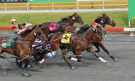 Larry Lincoln (red hood) pierces through the centre for Hayden Barnes and gets up in the last stride to nail Our Madiba at Albion Park last Saturday night. PHOTO: Dan Costello.